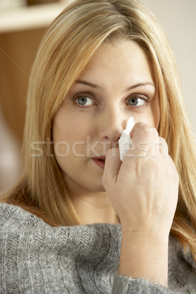 若い女性 冷たい 鼻をかむ 女性 家 ホーム ストックフォト © monkey_business