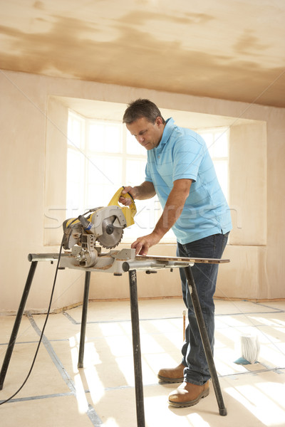 Stock photo: Builder Using Electric Saw