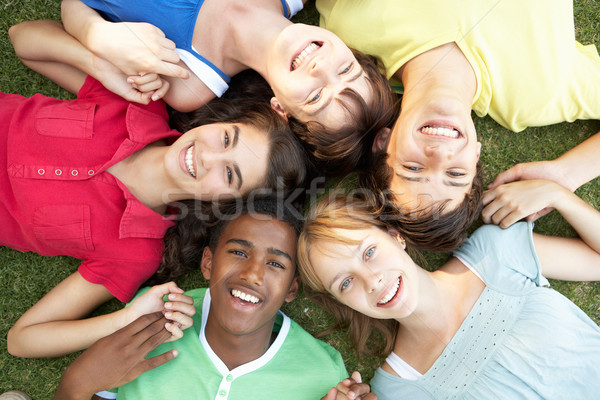 Group Of Teenagers Looking Up Into Camera Stock photo © monkey_business