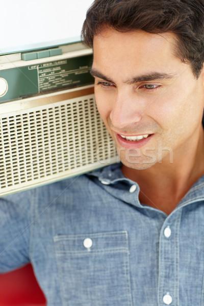 Młody człowiek słuchania radio muzyki człowiek włosy Zdjęcia stock © monkey_business