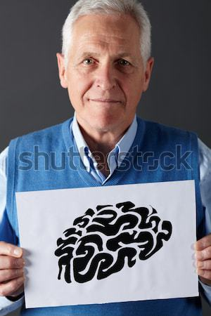 Senior man holding ink drawing of lungs Stock photo © monkey_business