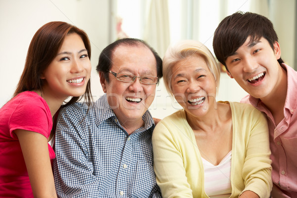 Portrait Of Chinese Parents With Adult Children Relaxing At Home Stock photo © monkey_business