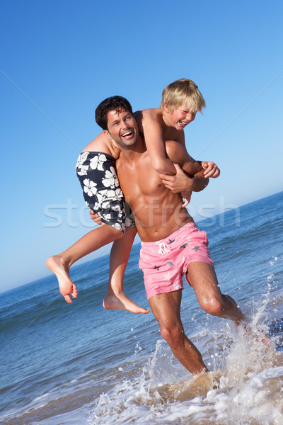 Vader zoon strand kinderen man zomer Stockfoto © monkey_business