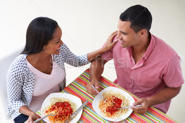Stock photo: Overhead View Of Couple Eating Meal Together
