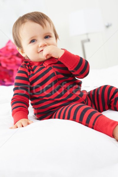 Seduta letto indossare pigiama baby Foto d'archivio © monkey_business