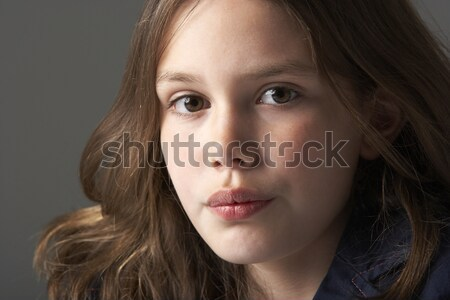 Thoughtful Girl Sitting In Studio Stock photo © monkey_business