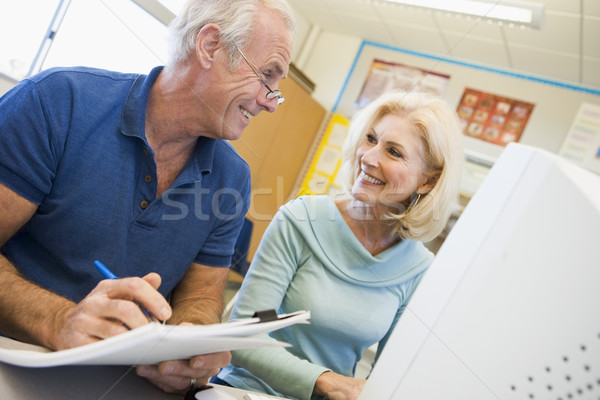 Male and female mature students working together on a computer  Stock photo © monkey_business