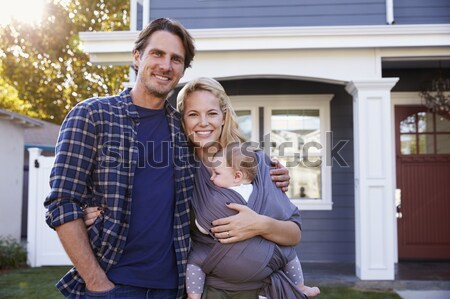 Couple standing in front of organic food store smiling Stock photo © monkey_business