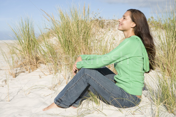 Young woman sitting in sand dunes Stock photo © monkey_business