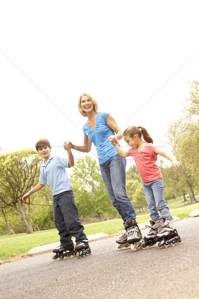 Grandmother And Grandchildren Skating In Park Stock photo © monkey_business