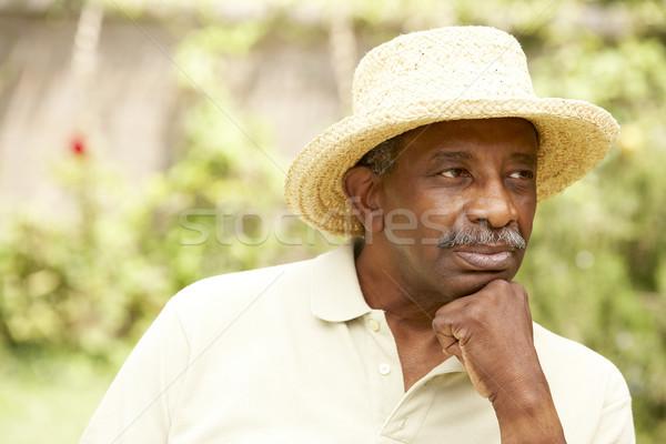 Zdjęcia stock: Starszy · człowiek · zamyślony · portret · hat · osoby
