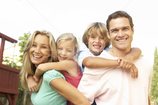 Portrait of Happy Family In Garden Stock photo © monkey_business