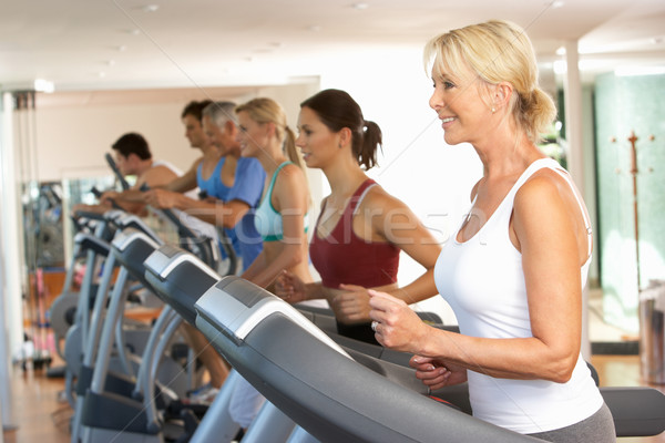 Senior Woman On Running Machine In Gym Stock photo © monkey_business