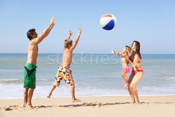 Young family play on beach Stock photo © monkey_business