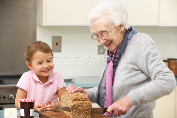 Grand-mère petite fille cuisine fille enfant Photo stock © monkey_business