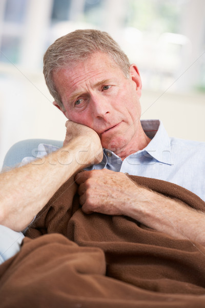 Sick, unhappy older man at home Stock photo © monkey_business