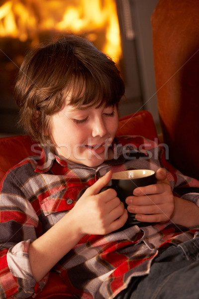 Détente boisson chaude confortable feu café Photo stock © monkey_business