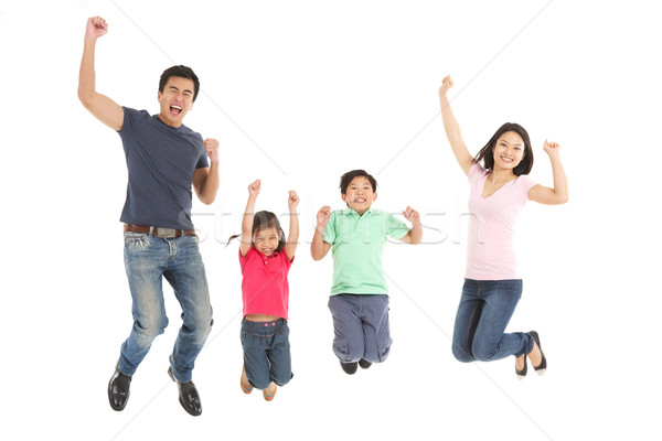 Studio Shot Of Chinese Family Jumping In Air Stock photo © monkey_business