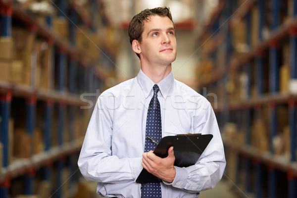 Manager magazzino appunti imprenditore finestra uomini Foto d'archivio © monkey_business