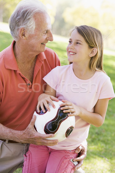 Grandfather and granddaughter outdoors with ball smiling Stock photo © monkey_business