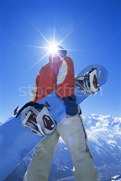 Stock photo: Young man with snowboard
