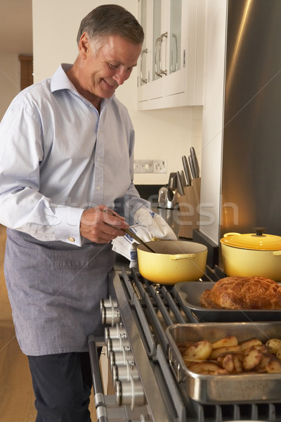 Man Cooking At Home Stock photo © monkey_business