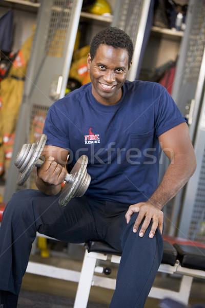 Ritratto pompiere fuoco stazione spogliatoio sorridere Foto d'archivio © monkey_business