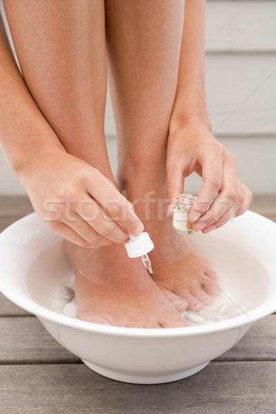 Woman giving herself pedicure Stock photo © monkey_business