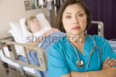 A Doctor And Nurse At The Reception Area Of A Hospital Stock photo © monkey_business