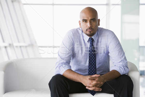 Businessman sitting on sofa in lobby Stock photo © monkey_business
