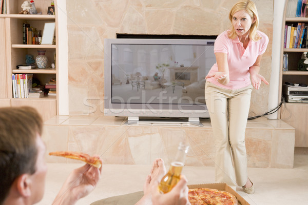 Wife Telling Husband Off For Drinking Beer And Eating Pizza Stock photo © monkey_business