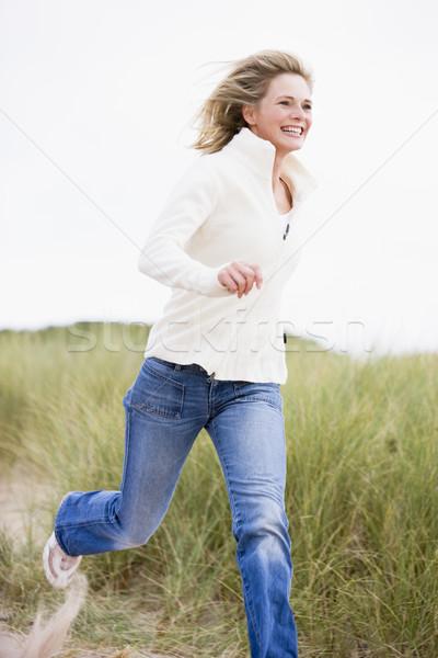 Stock photo: Woman running at beach smiling