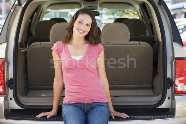 Woman sitting in back of van smiling Stock photo © monkey_business