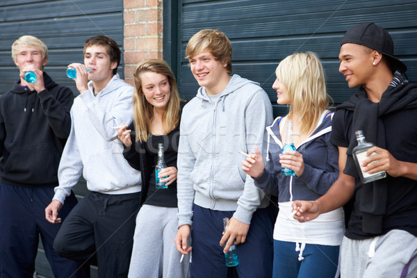 Group Of Teenagers Hanging Out Together Outside Drinking Stock photo © monkey_business