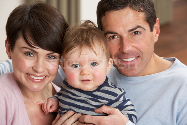 Stock photo: Portrait Of Proud Parents With Baby Son At Home
