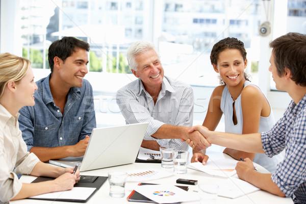 Mista gruppo incontro di lavoro business computer mani Foto d'archivio © monkey_business