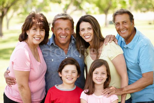 Több generáció spanyol család park lány gyerekek Stock fotó © monkey_business