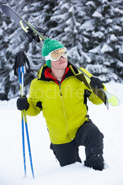 Young Man On Ski Holiday In Mountains Stock photo © monkey_business