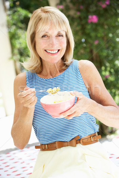 Senior Woman Enjoying Bowl Of Breakfast Cereal Stock photo © monkey_business
