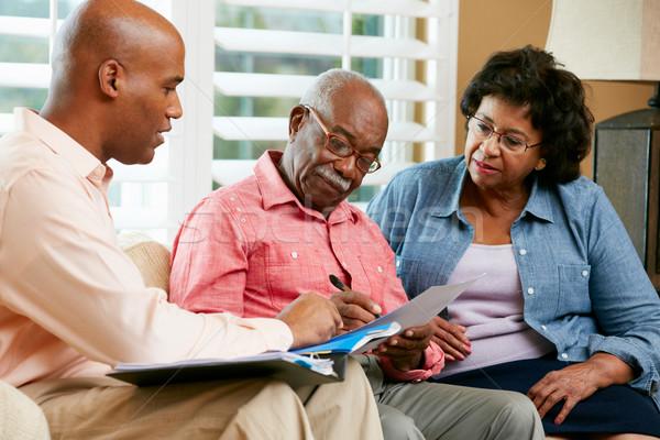Doradca finansowy mówić starszy para domu kobieta szczęśliwy Zdjęcia stock © monkey_business