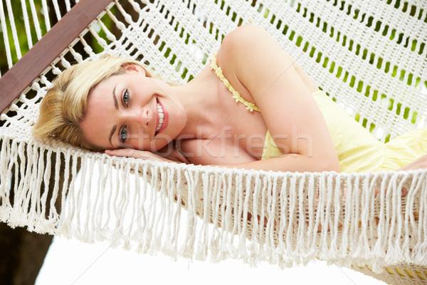 Mulher relaxante praia maca areia retrato Foto stock © monkey_business