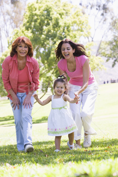 Grandmother with adult daughter and granddaughter in park Stock photo © monkey_business