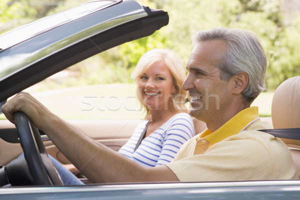 Couple in convertible car smiling Stock photo © monkey_business
