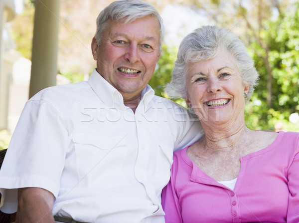 Stock photo: Senior couple smiling at camera
