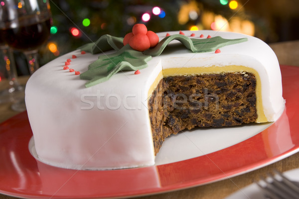 Decorated Christmas Fruit Cake with slices taken Stock photo © monkey_business