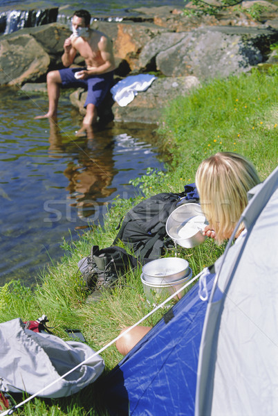 Couple camping in the great outdoors Stock photo © monkey_business