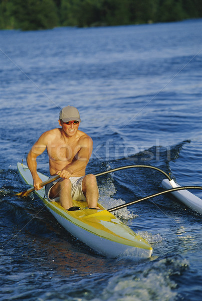 Man canoeing at sunset Stock photo © monkey_business