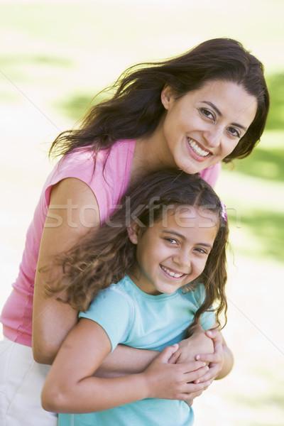 женщину улице улыбающаяся женщина улыбаясь Сток-фото © monkey_business