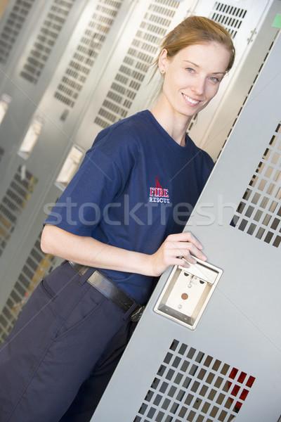 Portré tűzoltó tűz állomás szekrényes öltöző női Stock fotó © monkey_business