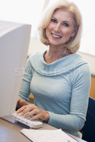 Mature female student learning computer skills Stock photo © monkey_business